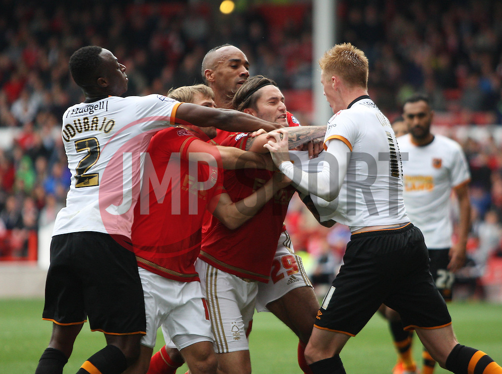 General view as Sam Clucas of Hull City (R) clashes with Nottingham Forest players - Mandatory byline: Jack Phillips / JMP - 07966386802 - 3/10/2015 - FOOTBALL - The City Ground - Nottingham, Nottinghamshire - Nottingham Forest v Hull City - Sky Bet Championship