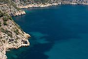 The rocky cliffs in the Cala La Granadella, Javea, Costa Blanca, Alicante province, Spain
