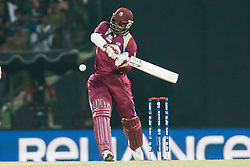 © Licensed to London News Pictures. 27/09/2012. West Indian Chris Gayle plays an attacking shot during the T20 Cricket World super 8's match between England Vs West Indies at the Pallekele International Stadium Cricket Stadium, Pallekele. Photo credit : Asanka Brendon Ratnayake/LNP