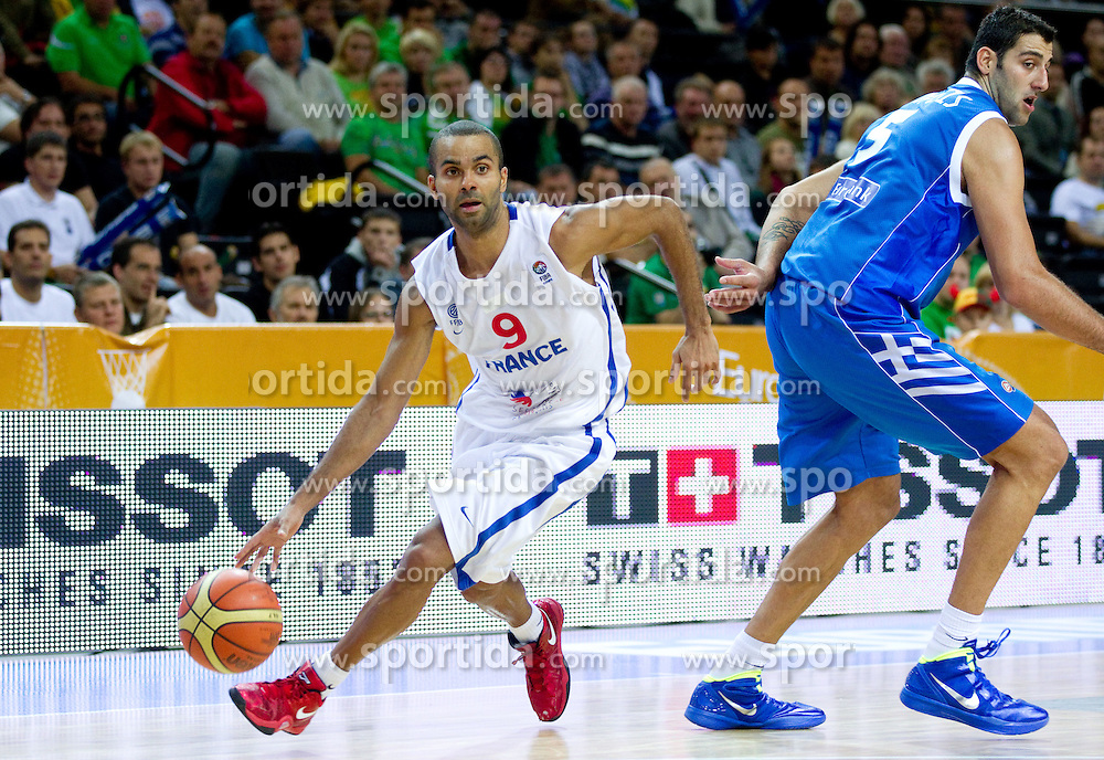 Tony Parker of France and Ioannis Bourousis of Greece  during basketball game between National basketball teams of France and Greece at of FIBA Europe Eurobasket Lithuania 2011, on September 15, 2011, in Arena Zalgirio, Kaunas, Lithuania. France defeated Greece 64-56.  (Photo by Vid Ponikvar / Sportida)