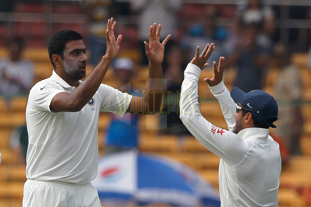 Ravichandran Ashwin of India celebrates the wicket of David Warner of Australia during day two of the second test match between India and Australia held at the M Chinnaswamy Stadium in Bangalore on the 5th March 2017. <br /> <br /> Photo by: Deepak Malik / BCCI/ SPORTZPICS
