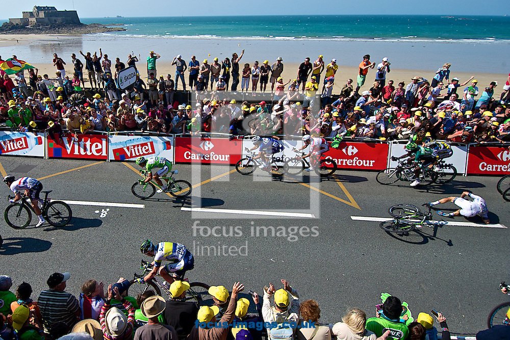 Picture by Ian Wadkins/Focus Images Ltd +44 7877 568959<br /> 09/07/2013<br /> Mark Cavndish (left) sprints away after colliding with Tom Veelers (right, on floor) during stage 10 of the 2013 Tour de France in Saint Malo, France.