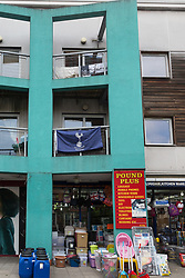 A lone Tottenham Hotspur banner adorns the balcony above a shop in Tottenham ahead of the club's Champions League final with Liverpool to be played at Atletico Madrid's Wanda Metropolitano Stadium in Madrid. Tottenham, London, May 31 2019.