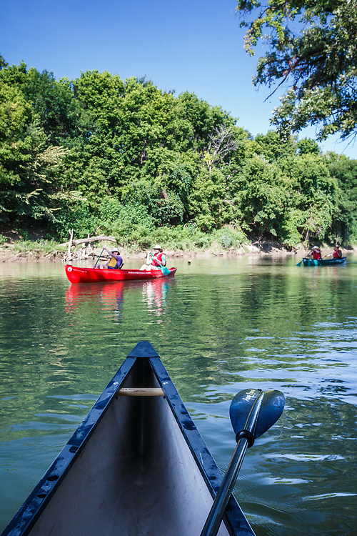 Canoers on Trinity River through Great Trinity Forest, Dallas, Texas, USA