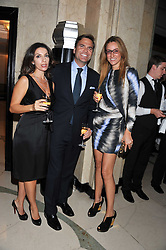 Left to right, JULIA AZMOUDEH, CHRIS THOMSEN and REBECCA KORNER at the Maggie's Autumn Summer Party held at Claridge's, Brook Street, London on 12th October 2011.
