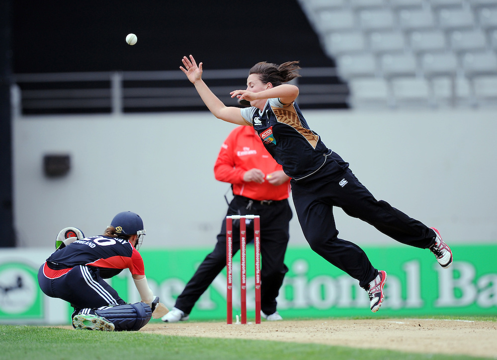 New Zealand's Kate Broadmore attempts to field off her own bowling over the head of England's Tammy Beaumont in the third twenty/20 International Womens Cricket match, Eden Park, Auckland, New Zealand, Wednesday, February 22 2012. Credit:SNPA / Ross Setford