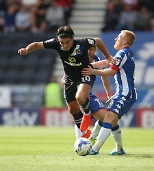 Ben Marshall of Blackburn Rovers (L) and David Perkins of Wigan Athletic in action - Mandatory by-line: Jack Phillips/JMP - 13/08/2016 - FOOTBALL - DW Stadium - Wigan, England - Wigan Athletic v Blackburn Rovers - EFL Sky Bet Championship