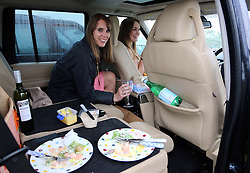 Two racegoers have their picnic lunch in the car at a wet and windy opening day of Glorious Goodwood in the UK, Tuesday, 30th July 2013 <br /> Picture by Stephen Lock / i-Images
