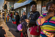 Averted looks at bus stop in Cape Town's CBD (Central Business District).  South Africa
