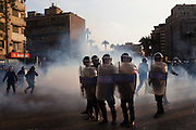 "Egyptian riot police battle thousands of protesters during January 25, 2011 ""Day of Anger"" demonstrations in downtown Cairo, Egypt. Today's protests across Egypt, inspired by the revolution in Tunisia, were organized by a wide range of opposition groups and intended to spark a similar movement in Egypt. Credit: Scott Nelson"
