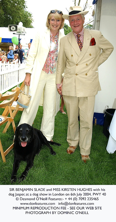 SIR BENJAMIN SLADE and MISS KIRSTEN HUGHES with his dog Jasper, at a dog show in London on 6th July 2004.PWY 40