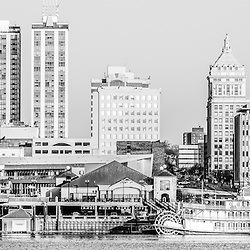 Peoria Illinois skyline panorama black and white photo with downtown city buildings along the Illinois River. Panoramic ratio is 1:3.