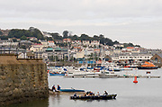 St Peter's Port, Guernsey, CHANNEL ISLANDS,   Launching in boats into to St Peter's habour, Friday, Practice day, , 2006 FISA Coastal Rowing  Challenge, 01/09/2006.  Photo  Peter Spurrier, © Intersport Images,  Tel +44 [0] 7973 819 551,  email images@intersport-images.com