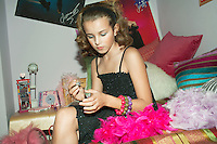 Fashionable Young Girl Applying Nail Polish in trendy bedroom