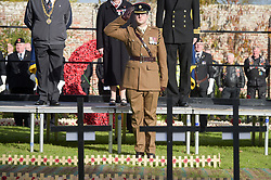 A member of the British Army salutes after planting a cross in the Royal Wootton Bassett Field of Remembrance at Lydiard park, Swindon, as it opens to honour and remember those who have been lost serving in the Armed Forces.