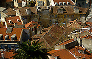 Aerial landscape of old houses and tiled roofs of the Portuguese capital Lisbon's medieval and Moorish Alfama district.