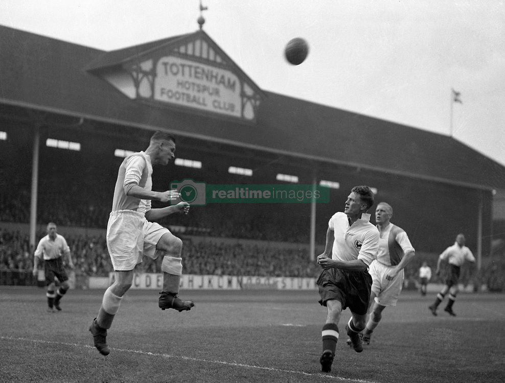 Coventry City's George Mason (l) heads clear from Tottenham Hotspur's Johnny Morrison (r)