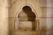 Liturgical basin in a stone niche, in the wall of the Chapel, on the first floor of the Chapel Tower, built 2014, at the Chateau de Guedelon, a castle built since 1997 using only medieval materials and processes, photographed in 2017, in Treigny, Yonne, Burgundy, France. The Guedelon project was begun in 1997 by Michel Guyot, owner of the nearby Chateau de Saint-Fargeau, with architect Jacques Moulin. It is an educational and scientific project with the aim of understanding medieval building techniques and the chateau should be completed in the 2020s. Picture by Manuel Cohen