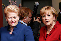 Lithuanian President Dalia Grybauskaite (L) and German Chancellor Angela Merkel (R) arrive for a family photo during an European Union summit in Brussels, Belgium, 24 October 2013.