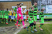 Forest Green Rovers Liam Noble(15) and the mascots lead the teams out during the Vanarama National League match between Forest Green Rovers and Torquay United at the New Lawn, Forest Green, United Kingdom on 1 January 2017. Photo by Shane Healey.