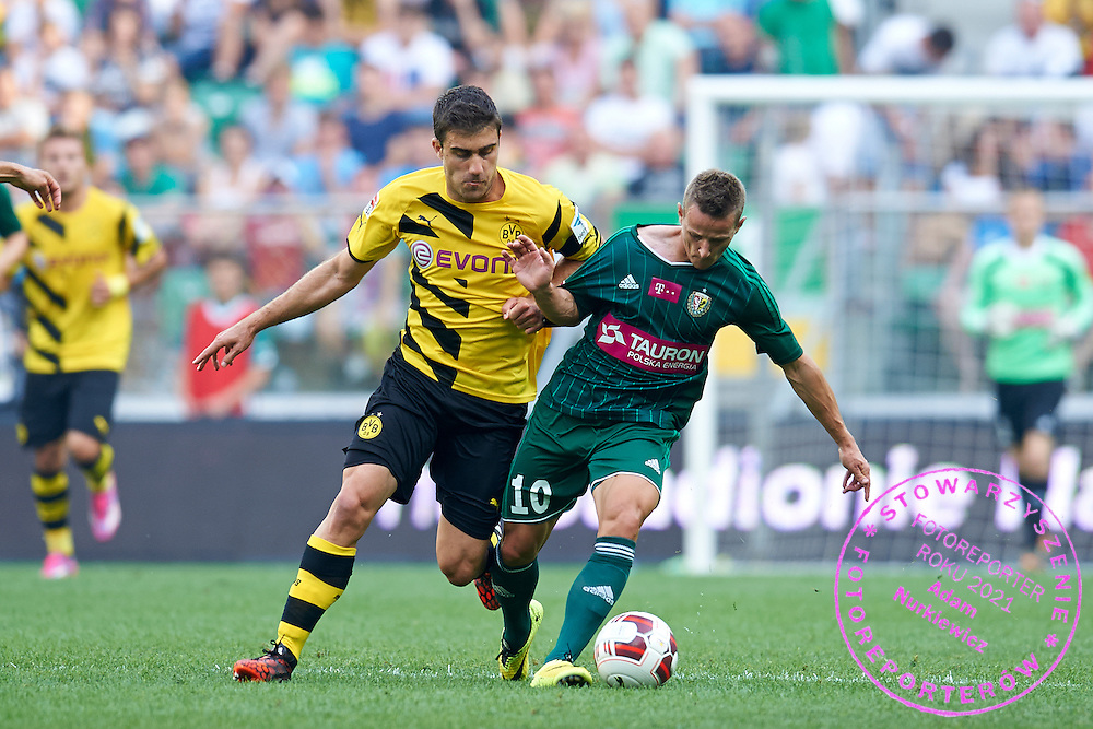 (R) Robert Pich of Slask Wroclaw fights for the ball with (L) Sokratis Papastathopoulos of Dorussia Dortmund during international friendly soccer match between WKS Slask Wroclaw and BVB Borussia Dortmund on Municipal Stadium in Wroclaw, Poland.<br /> <br /> Poland, Wroclaw, August 6, 2014<br /> <br /> Picture also available in RAW (NEF) or TIFF format on special request.<br /> <br /> For editorial use only. Any commercial or promotional use requires permission.<br /> <br /> Mandatory credit:<br /> Photo by &copy; Adam Nurkiewicz / Mediasport