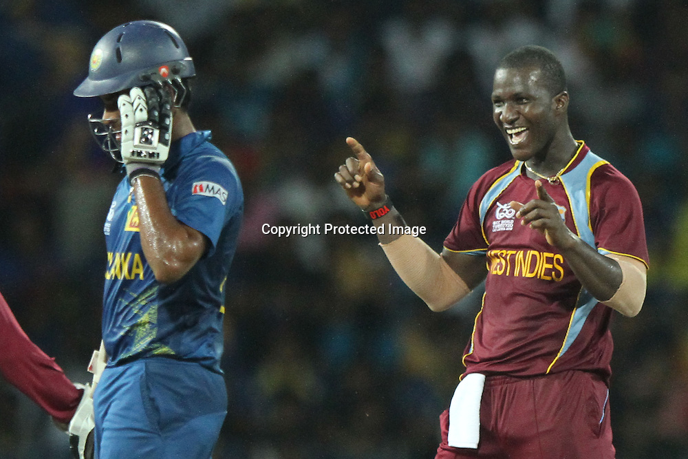 West Indies bowler Darren Sammy (R) celebrates the dismissal of Sri Lanka&rsquo;s Lahiru Thirimanna (L) during the ICC World Twenty20 final between Sri Lanka and the West Indies held at the Premadasa Stadium in Colombo, Sri Lanka on the 7th October 2012.<br /> <br /> Photo by Sanka vidanagama/SPORTZPICS/PHOTOSPORT