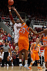 Dec 20, 2011; Stanford CA, USA;  Stanford Cardinal forward Nnemkadi Ogwumike (30) shoots over Tennessee Lady Volunteers forward/center Vicki Baugh (21) during the second half at Maples Pavilion.  Stanford defeated Tennessee 97-80. Mandatory Credit: Jason O. Watson-US PRESSWIRE