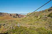 Zip lining with the Perrine Bridge beyond in the Snake River Canyon with Zip the Snake in Twin Falls, Idaho. MR