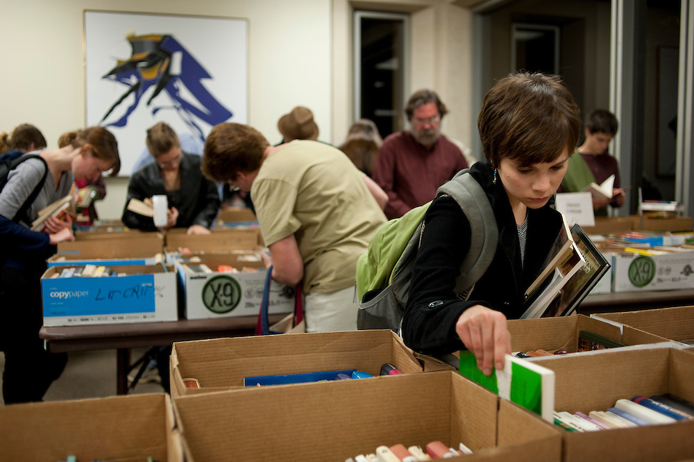 Caitlin Kraus, a senior in music therapy, looks through boxes of books during The Friends of the Libraries of Ohio University book sale on Thursday night, Nov. 4, 2010 on the fourth floor of Alden Library. The book sale continues on Friday from 10 a.m. to 6 p.m. and on Saturday from 10 a.m. to 4 p.m.
