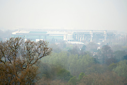 © Licensed to London News Pictures. 02/04/2014. Richmond, UK. Twickenham Stadium stands in the mist.  Visitors to Richmond Park had low visibility today April 2nd 2013. High levels of air pollution are set to spread across England and are expected  to get worse. Photo credit : Stephen Simpson/LNP