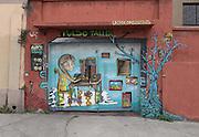 Street art adorns the doors of a workshop in Cerro Alegre, Valparaiso.