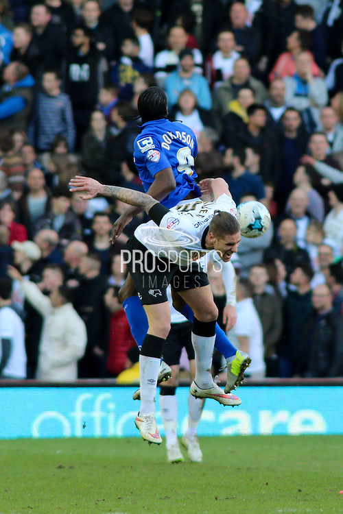 Derby County defender Raul Albentosa (36) wins the ball during the Sky Bet Championship match between Derby County and Birmingham City at the iPro Stadium, Derby, England on 7 March 2015. Photo by Aaron Lupton.