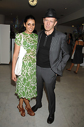 SERENA REES and PAUL SIMONON at a reception hosted by Vogue magazine to launch photographer Tim Walker's book 'Pictures' sponsored by Nude, held at The Design Museum, Shad Thames, London SE1 on 8th May 2008.<br />