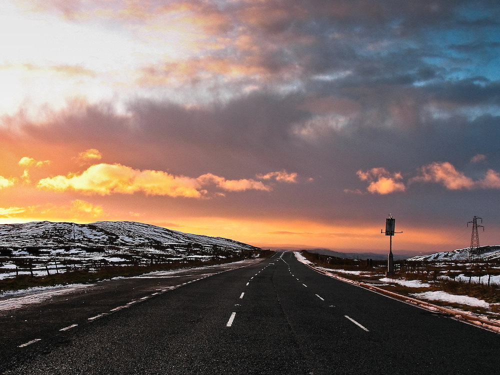 Birkbeck fells, from Shap Summit on the A6, at sunset in the winter, snow, Cumbria, England, Uk