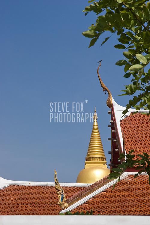 Iconic Thai temple features against a clear blue sky, Phetchaburi, Thailand