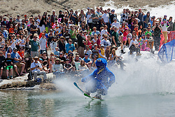 """Cushing Classic at Squaw Valley 9"" - Photograph of a skier crossing a pond during the Cushing Classic at Squaw Valley, USA."