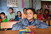 A boy in a lesson at the Alternate Learning Hub, Subhai, Himalayas, India. The school is organized and funded by the Pragya charity.  Pragya is a non-profit organization providing education and information services in high altitude areas in the Himalayas.