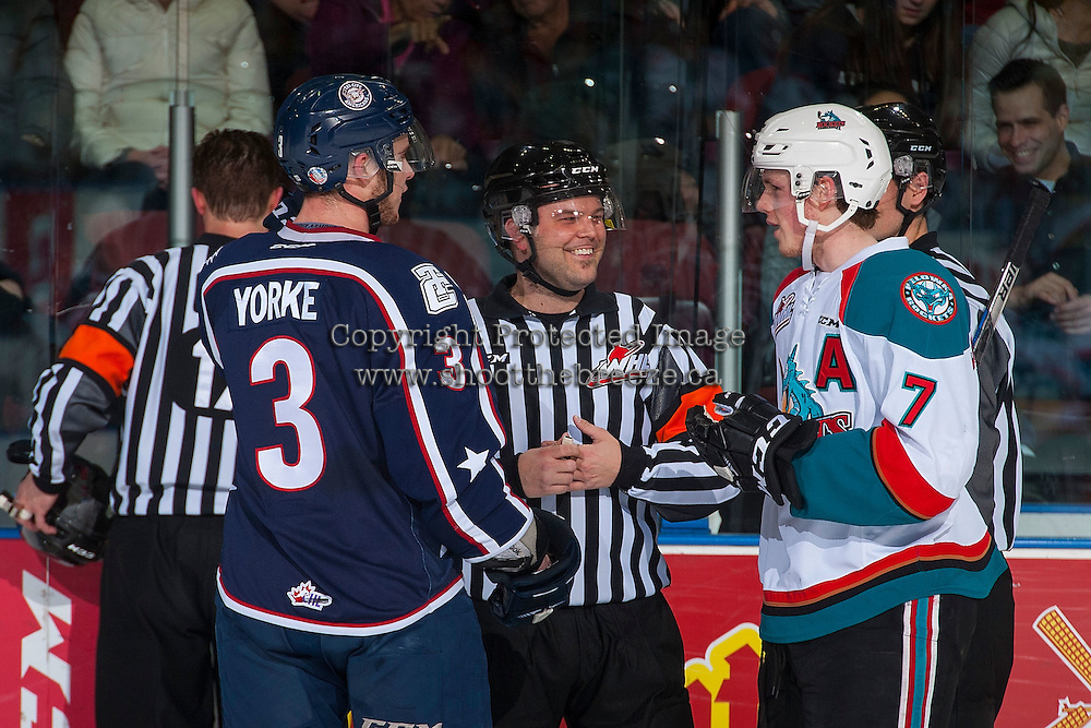 KELOWNA, CANADA - MARCH 4: Dalton Yorke #3 of the Tri-City Americans and Lucas Johansen #7 of the Kelowna Rockets speak to referee Chris Crich as a goal is reviewed  on March 4, 2017 at Prospera Place in Kelowna, British Columbia, Canada.  (Photo by Marissa Baecker/Shoot the Breeze)  *** Local Caption ***