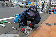 Cleaning the streets of radiation in Fukushima City, Japan.<br />