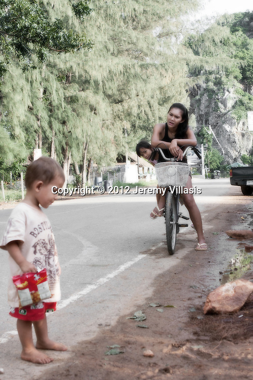 Mother and daughter go for a bicycle ride in Khao Ka Lok.