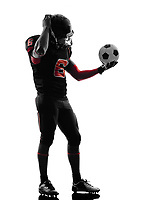 one american football player soccer ball confused in silhouette shadow on white background
