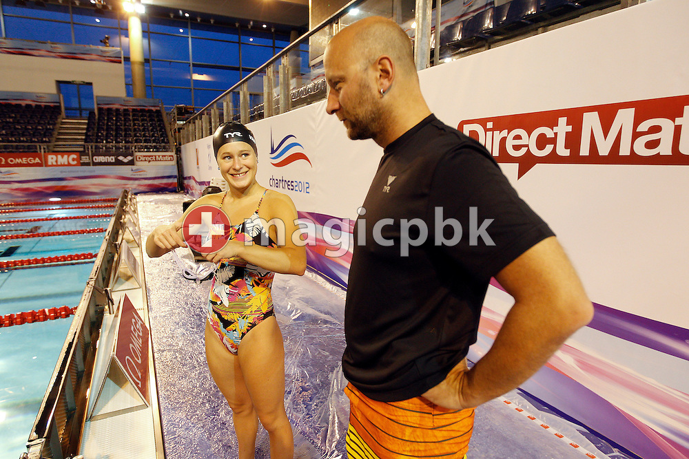 Martina VAN BERKEL (L) of Switzerland talks to her coach Dirk REINICKE during a training session one day prior to the start of the 16th European Short Course Swimming Championships held at the aquatic complex L'Odyssee in Chartres, France, Wednesday, Nov. 21, 2012. (Photo by Patrick B. Kraemer / MAGICPBK)