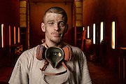 Industrial portrait of a painter in a fabrication facility in Dallas, Texas.