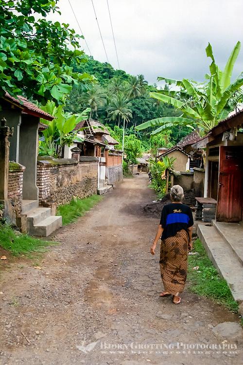Bali, Karangasem, Tenganan. A traditional Bali Aga village. Tenganan is located on the fertile hills stretching up to Gunung Agung. An old woman in a Tenganans street.