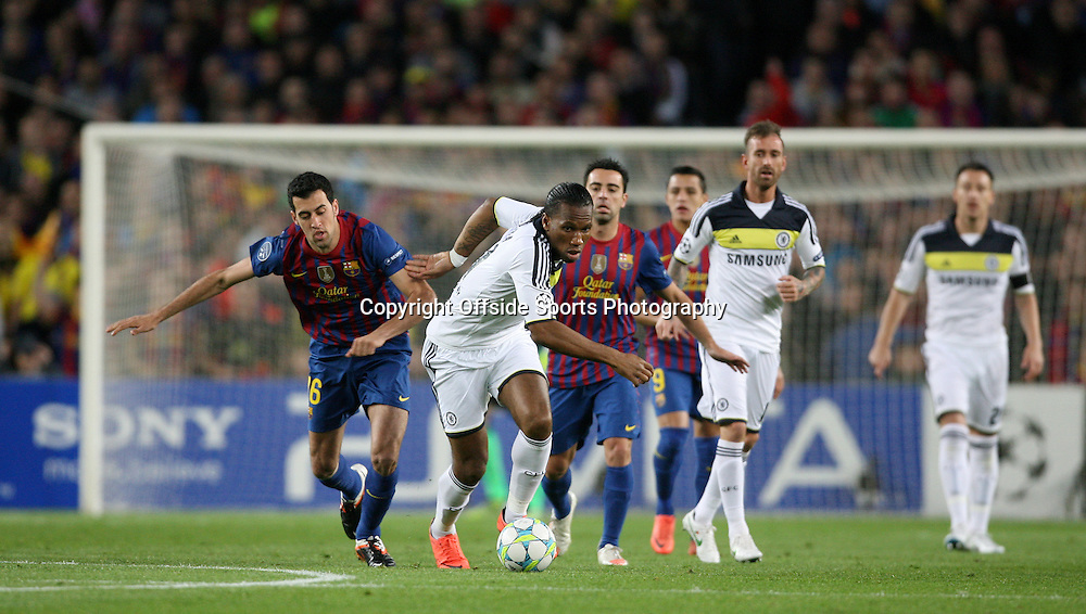 24/04/2012 - UEFA Champions League - Semi Final (2nd Leg) - FC Barcelona vs. Chelsea - Didier Drogba of Chelsea gets away from Sergio Busquets of Barcelona - Photo: Simon Stacpoole / Offside.