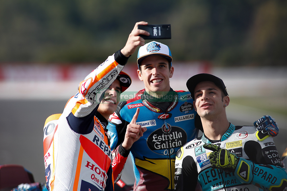 November 17, 2019, Cheste, VALENCIA, SPAIN: Marc Marquez, rider of Repsol Honda Team from Spain, Alex Marquez, rider of EG 0,0 Marc VDS from Spain,  and Lorenzo Dalla Porta, raider of Leopard Racing from Italy, takes a selfie attends during the World Champion photo during the Valencia Grand Prix of MotoGP World Championship celebrated at Circuit Ricardo Tormo on November 16, 2019, in Cheste, Spain. (Credit Image: © AFP7 via ZUMA Wire)