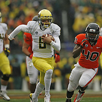 Oregon quarterback Marcus Mariota heads to the end zone on a 42 yard touchdown run in the first quarter of the 116th annual Civil War game on Saturday Nov. 24, 2012.