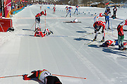 2/26/06 -- The 2006 Torino Winter Olympics -- Pragelato , Italy. -- Cross-Country Men's 50 KM -- .Racers collapse at the end of the men's 50 km cross country race..Photo by Scott Sady, USA TODAY staff.