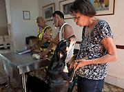 Nor García, Enrique, and Maria in the office area of Aniplant, Cuba.