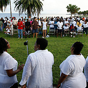 (09/14/08).Sevenx7 is an effort by 49 plus churches to bring peace and stop the violence on the South Side of St. Petersburg.They held seven revivals in seven different places for the last seven days. Tonight men women and children that were saved at the seven revival sights will be baptized in Tampa Bay at North Shore Park..Created By.WILLIE J. ALLEN JR.(Photos WILLIE J. ALLEN JR. | Times).